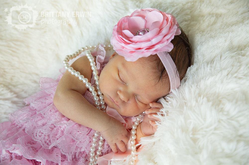Indianapolis-lifestyle-portrait-photographer-newborn-baby-girl-flower-headband-pink-romper.jpg
