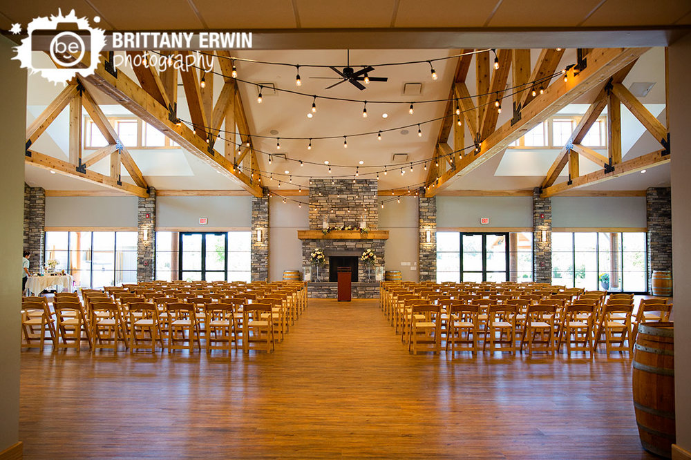 Sycamore-at-Mallow-Run-ceremony-location-indoor-fireplace-wooden-chairs.jpg