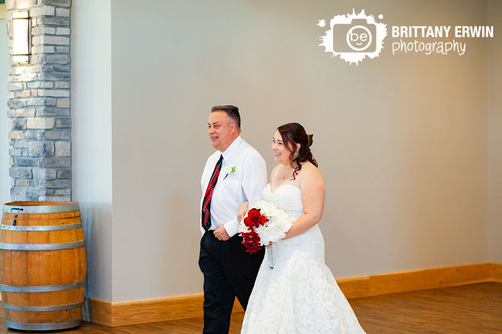 father-of-the-bride-walking-down-aisle-indoor-ceremony-sycamore-at-mallow-run-winery.jpg