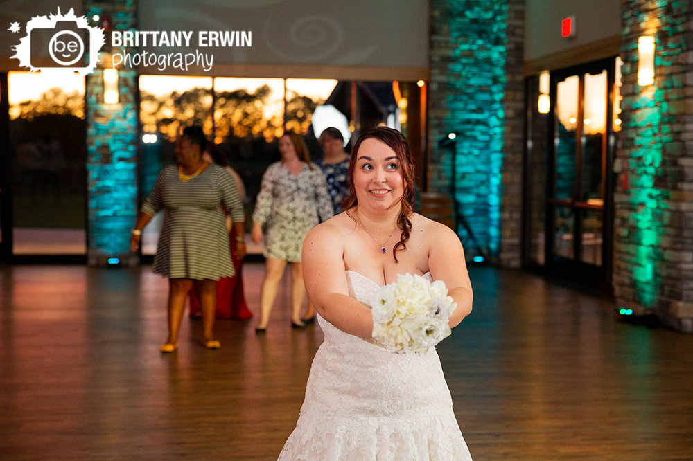 Sycamore-at-Mallow-Run-reception-photographer-bride-throwing-toss-bouquet.jpg