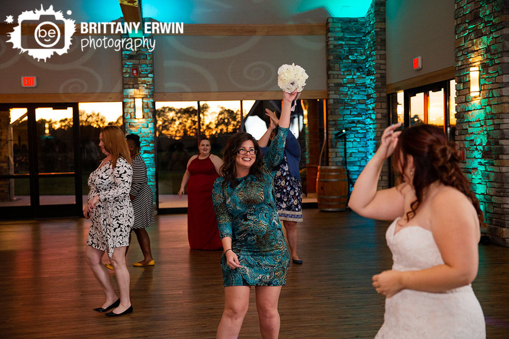 Sycamore-at-Mallow-Run-reception-photographer-bouquet-toss-caught.jpg