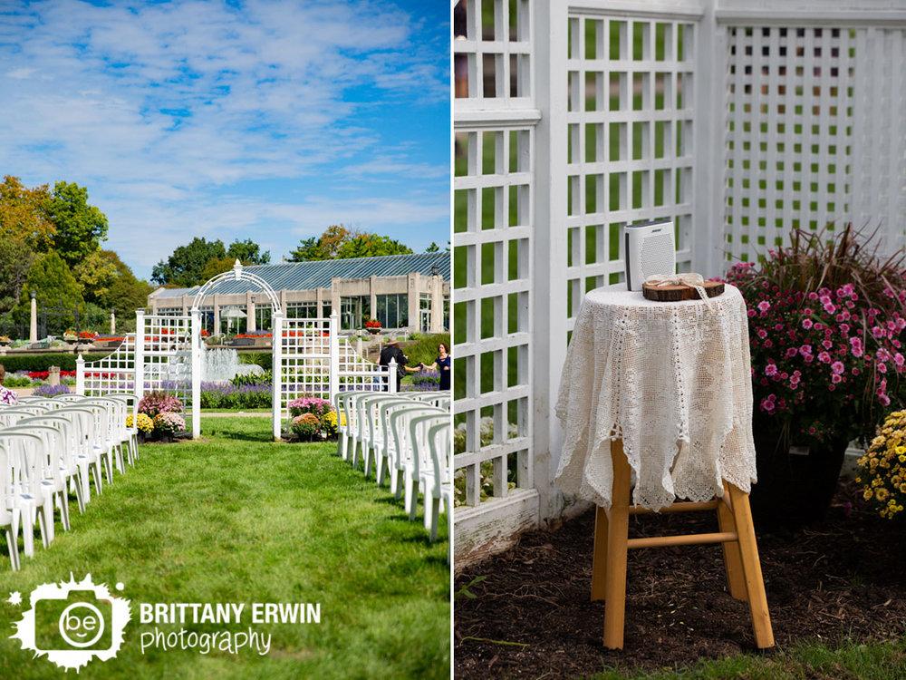 Wedding-photographer-ceremony-at-garfield-park-sunken-garden-flowers-at-altar.jpg