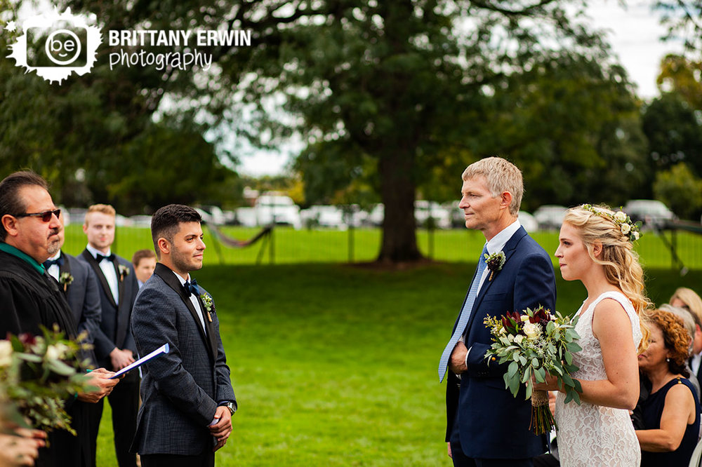 Wedding-photographer-bride-with-father-of-bride-walking-down-aisle-groom-ceremony.jpg