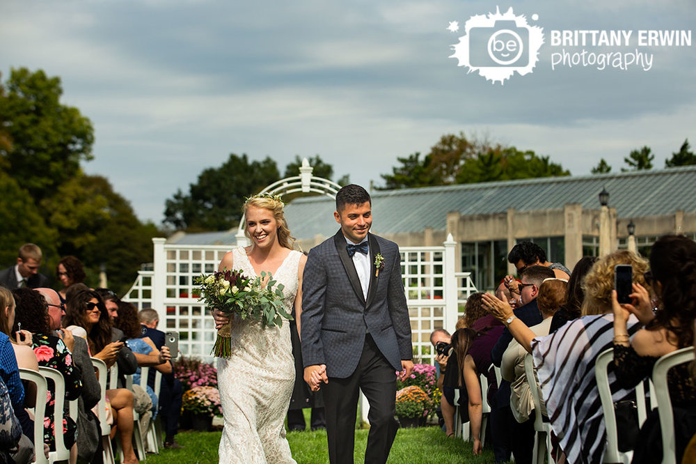 Bride-and-groom-announced-walk-down-aisle-as-husband-and-wife-couple-garfield-park-sunken-garden.jpg