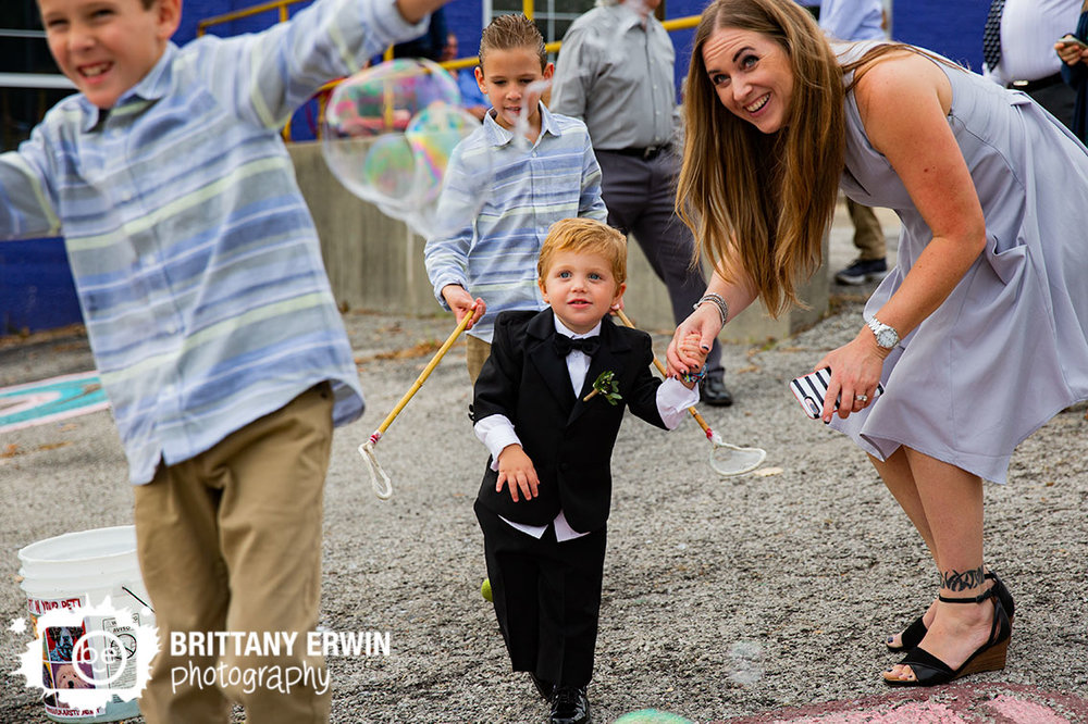 Fountain-Square-Tube-Factory-Art-Space-bubble-man-wedding-photographer-son-of-bride-and-groom-play-outside.jpg