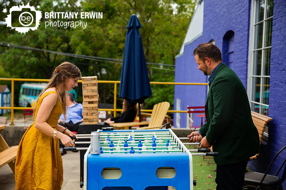 Fountain-Square-wedding-photographer-guests-play-foosball-outside-fun-reception-venue-Tube-Factory-Art-Space.jpg