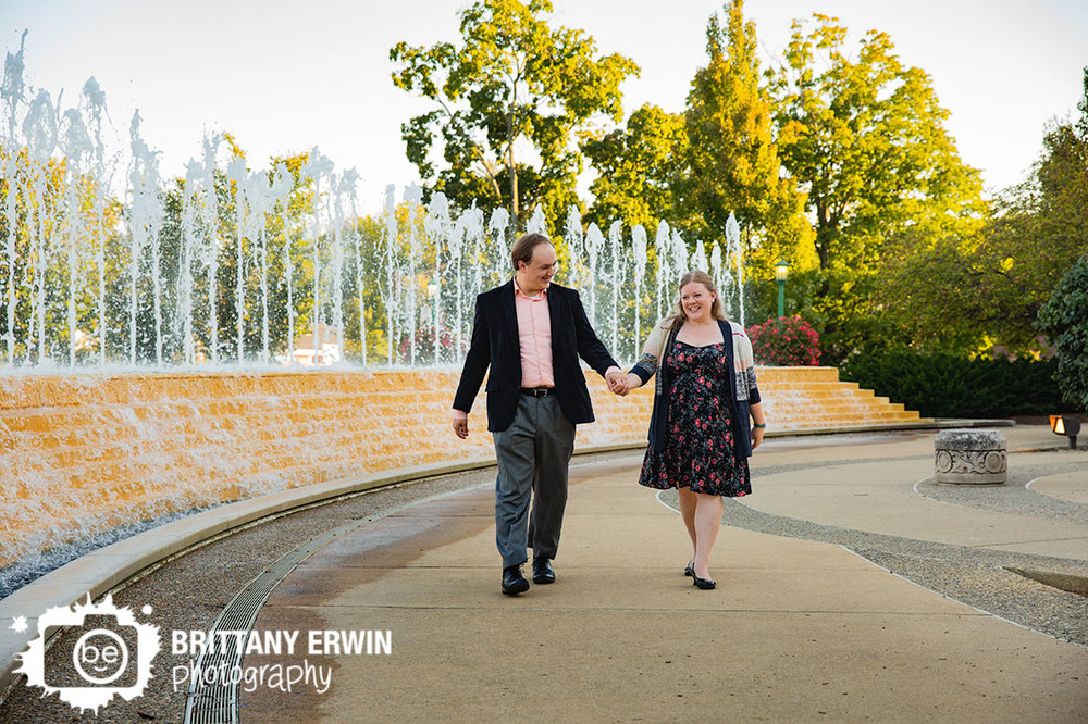 Bloomington-Indiana-couple-walking-next-to-fountain-engagement-portrait-photographer.jpg