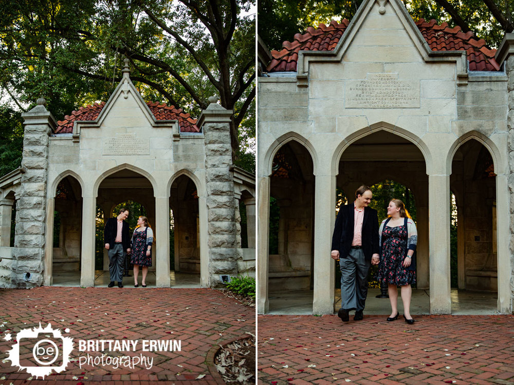 Bloomington-Indiana-University-engagement-portrait-photographer-stone-gazebo-couple-walking-in-fall.jpg