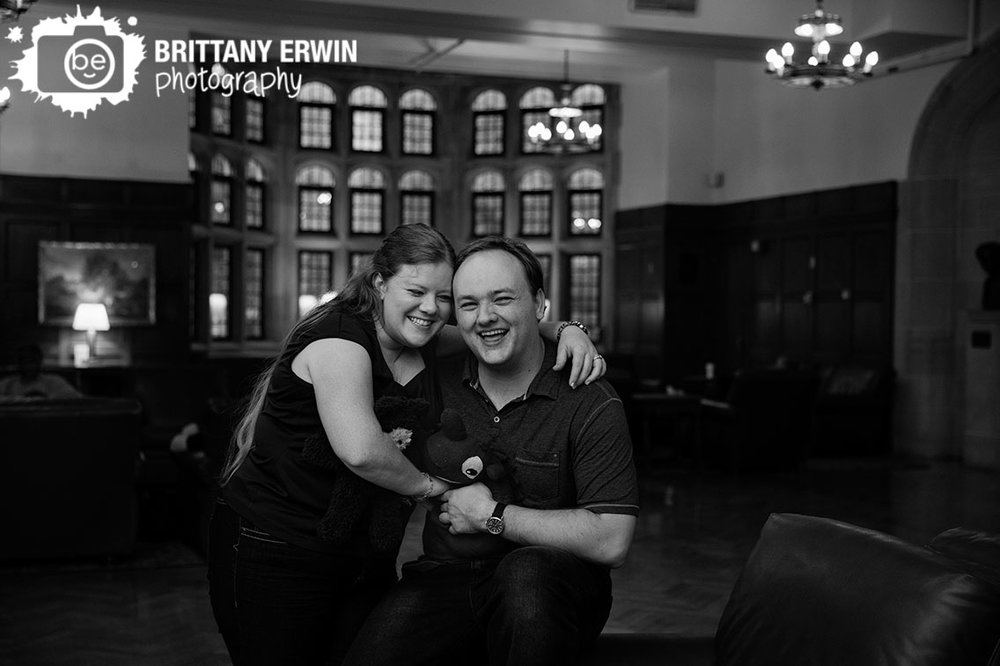 Bloomington-Indiana-University-engagement-portrait-photographer-couple-in-union-building-laughing.jpg