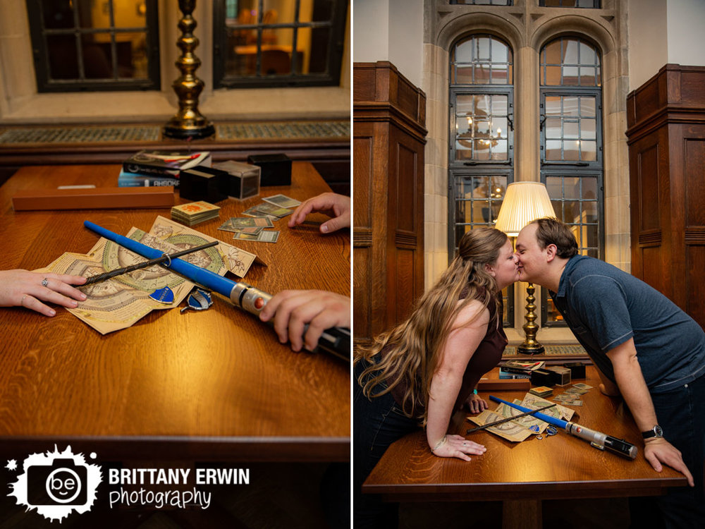 Bloomington-Indiana-University-couple-engagement-portrait-harry-potter-wand-star-wars-light-saber-kiss-over-table.jpg