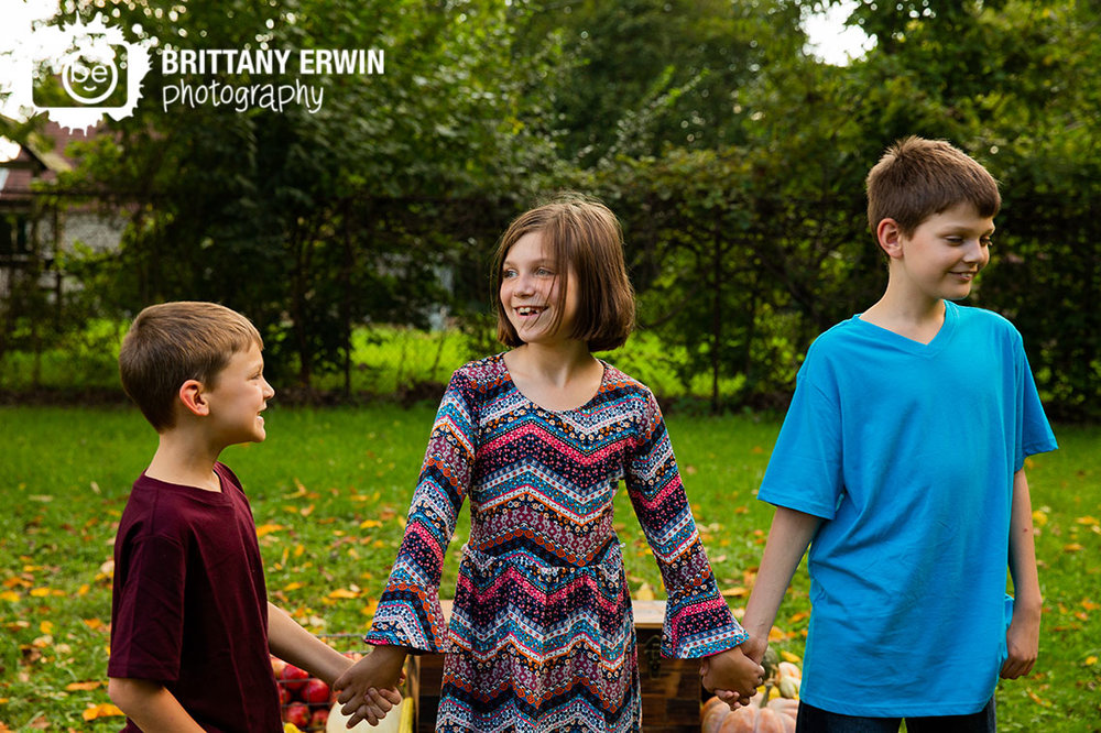 Indianapolis-fall-portrait-photographer-siblings-brothers-sister-walking-outside.jpg