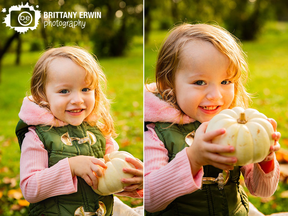 Indianapolis-fall-portrait-photographer-vest-pumpkin-toddler-girl-outdoor.jpg