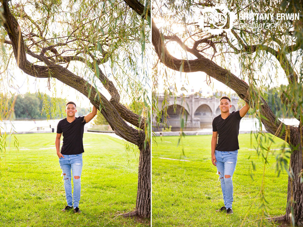 Downtown-Indianapolis-high-school-senior-portrait-photographer-leaning-on-tree-at-end-of-canal.jpg