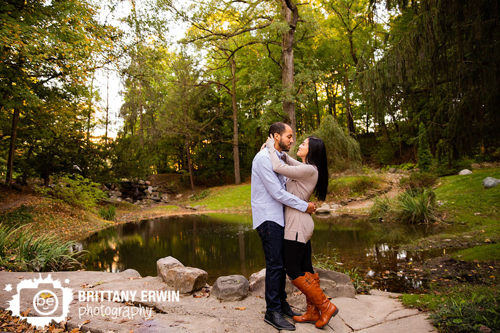 Holcomb-Gardens-fall-pond-couple-on-ledge-engagement-portraits.jpg