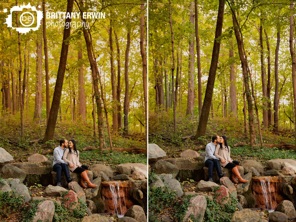 autumn-forest-waterfall-couple-on-ledge-engagement-portrait-photographer.jpg