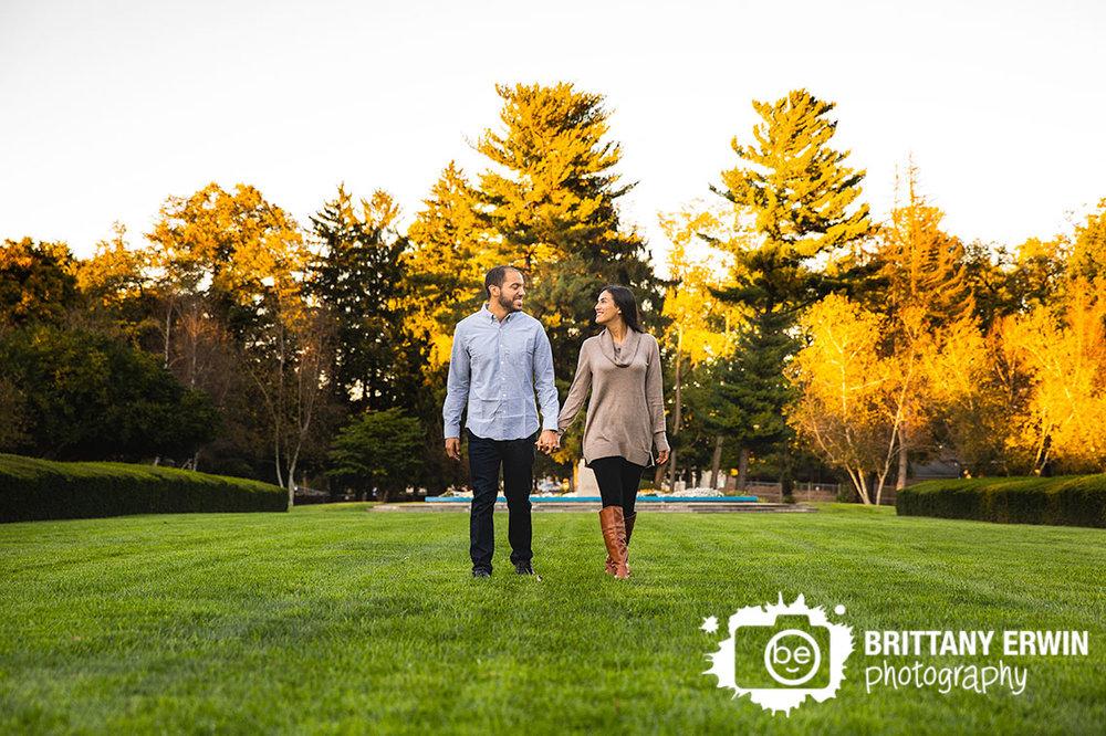 Autumn-leaves-outdoor-engagement-portrait-photographer-couple-walking.jpg