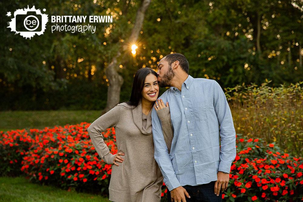 Holcomb-Gardens-engagement-portrait-photographer-couple-sunset-temple-kiss-flowers.jpg
