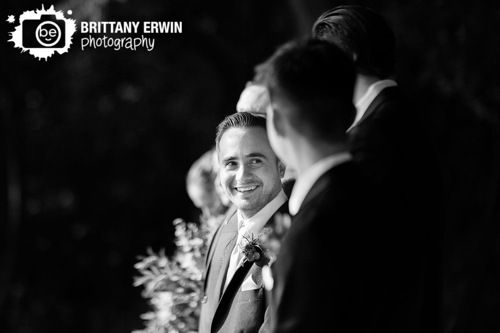 Wea-Creek-Orchard-wedding-ceremony-photographer-groom-reaction-at-altar.jpg