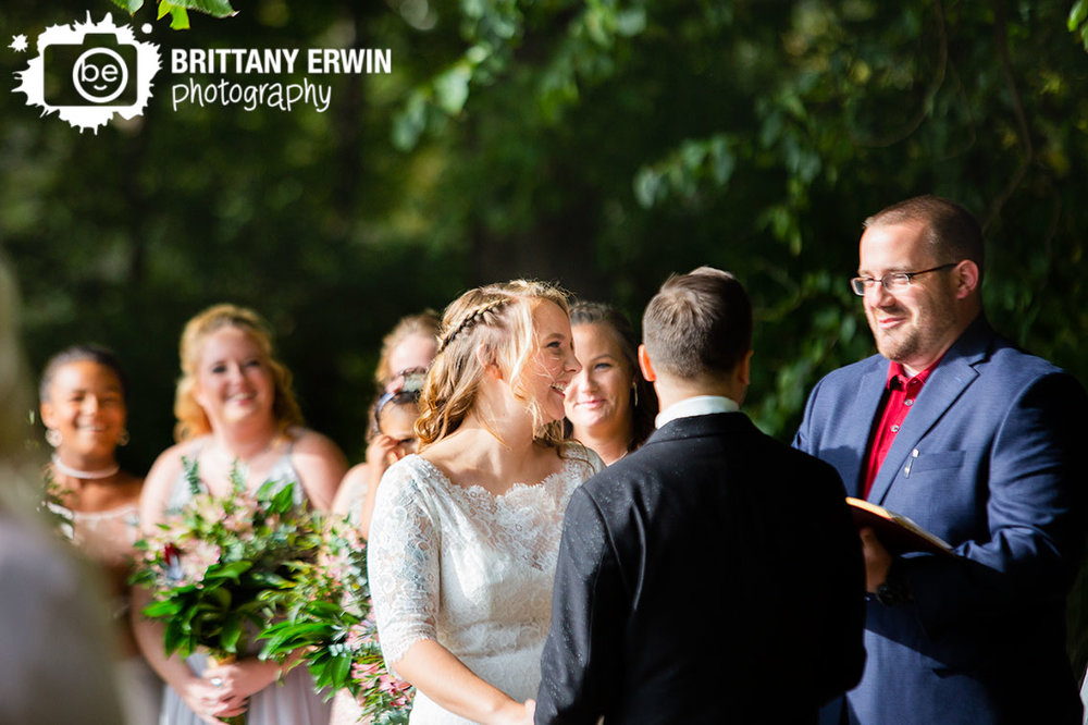 Wedding-photographer-bride-laughing-fun-ceremony-outdoor-orchard.jpg