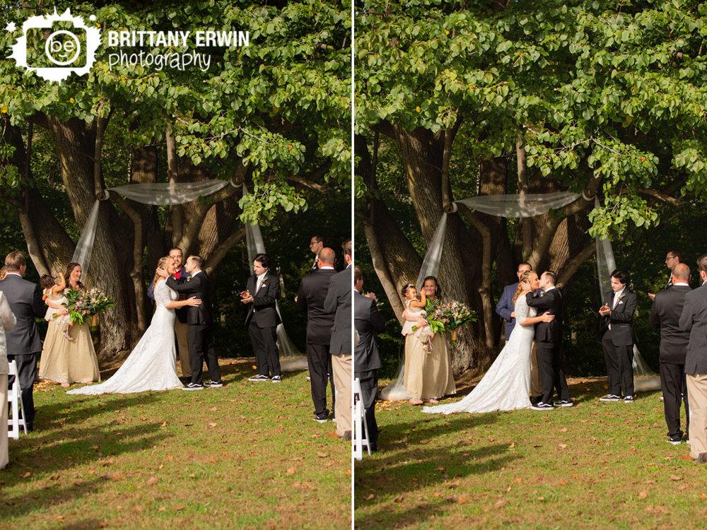 Wea-Creek-Orchard-wedding-tree-ceremony-first-kiss-cheer.jpg