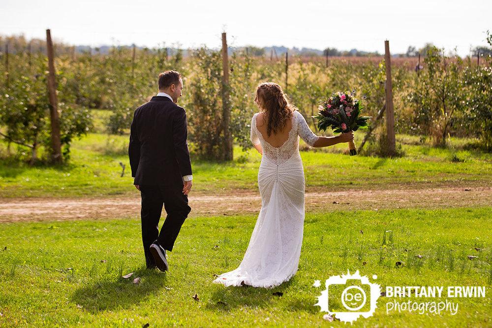 Lafayette-Indiana-orchard-wedding-photographer-husband-wife-exit.jpg
