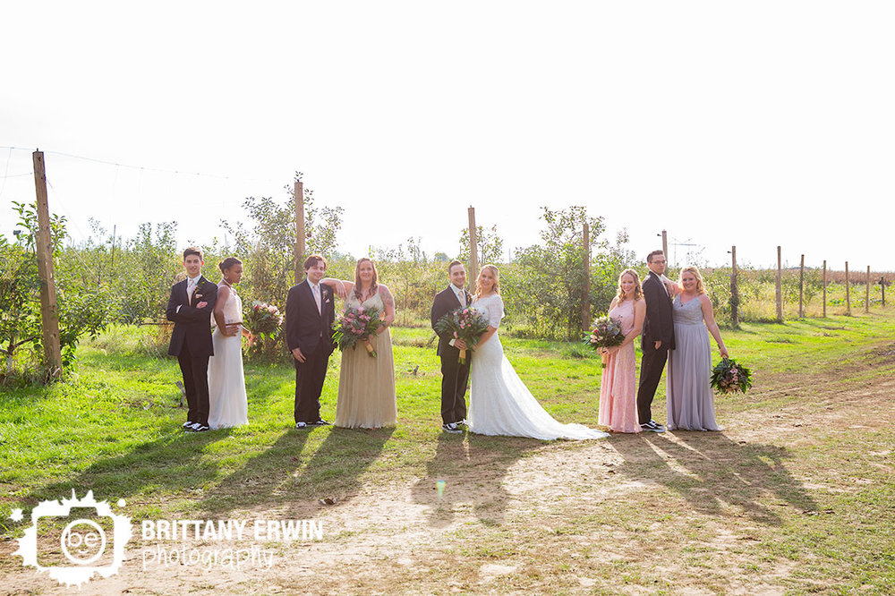 Wea-Creek-Orchard-wedding-photographer-bridal-party-group-apple-tree-field.jpg