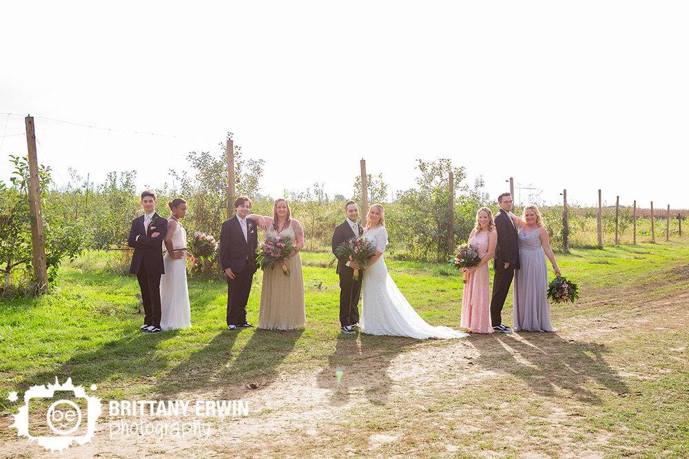 Wea-Creek-Orchard-wedding-photographer-bridal-party-group-apple-tree-field.jpg