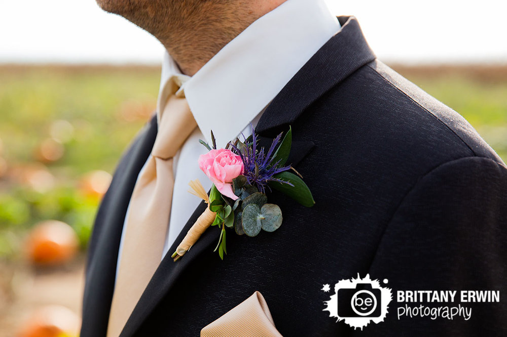 Wea-Creek-Orchard-wedding-photographer-boutonniere-flowers-pinned.jpg