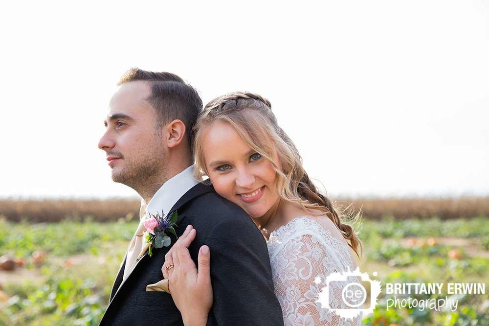 Fall-wedding-photographer-couple-in-pumpkin-patch.jpg