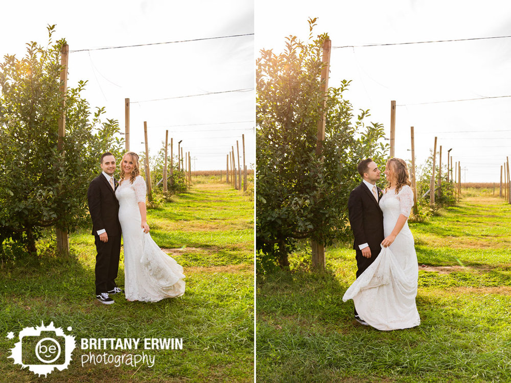 Wea-Creek-Orchard-wedding-photographer-apple-tree-line-couple.jpg
