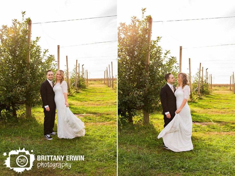 Wea-Creek-Orchard-wedding-photographer-apple-tree-line-couple.jpg