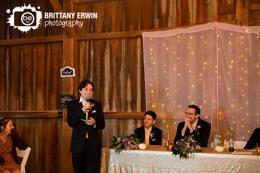 Wea-Creek-Orchard-wedding-photographer-best-man-toast-indoor-barn-venue.jpg
