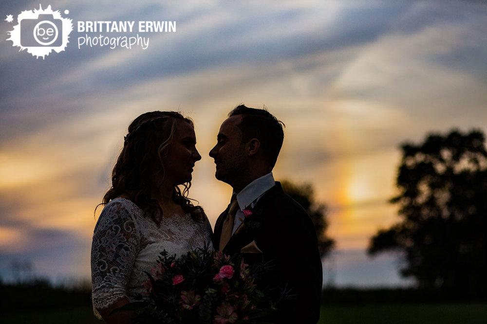Wea-Creek-Orchard-wedding-photographer-couple-silhouette-sunset-blue-gold-sky.jpg