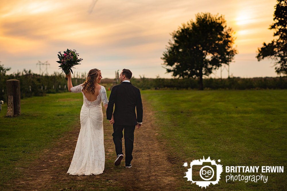Wea-Creek-Orchard-lafayette-Indiana-wedding-photographer-couple-walk-into-sunset.jpg