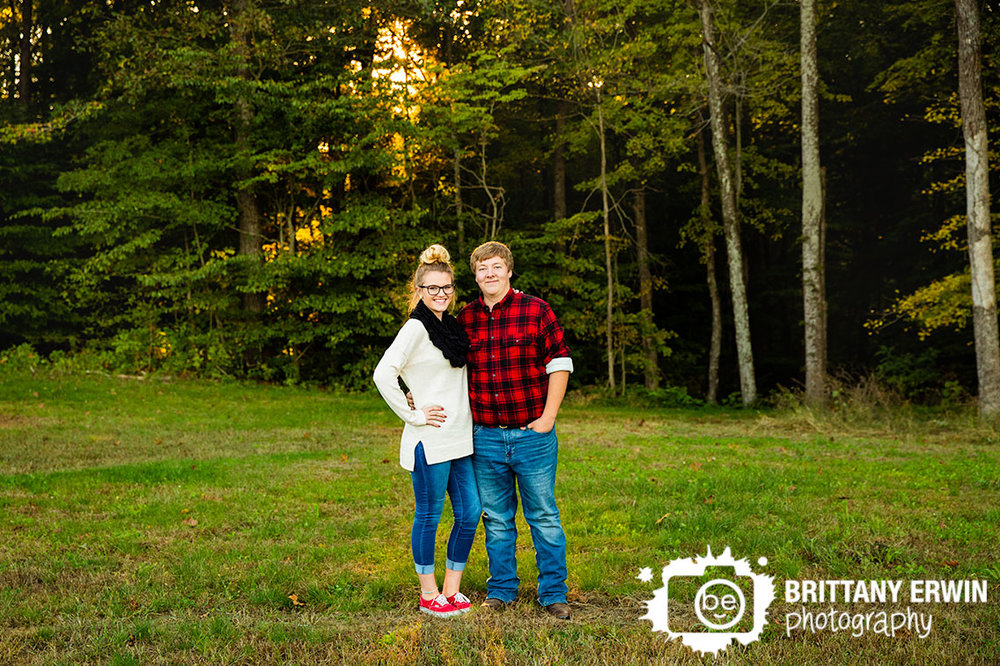 Engagement-portrait-photographer-couple-at-sunset-with-tree-line.jpg
