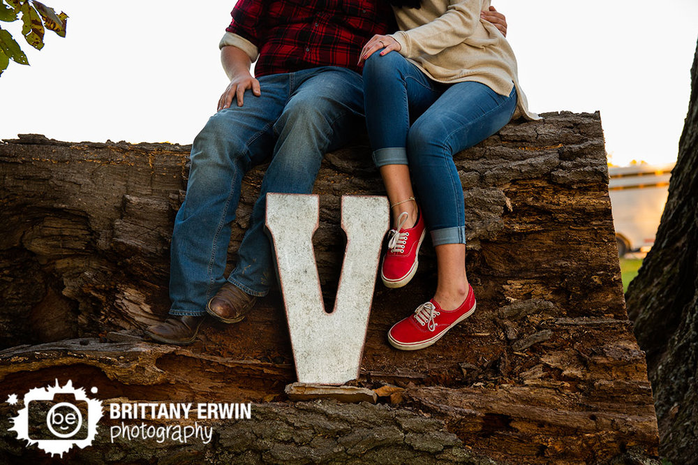 monogram-engagement-portrait-photographer-couple-on-log-boots.jpg