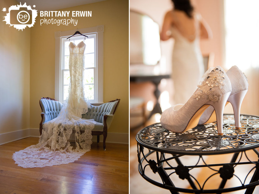 Bridal-Gown-Enzoani-hanging-from-window-with-antique-couch-shoes-with-bride-in-background.jpg