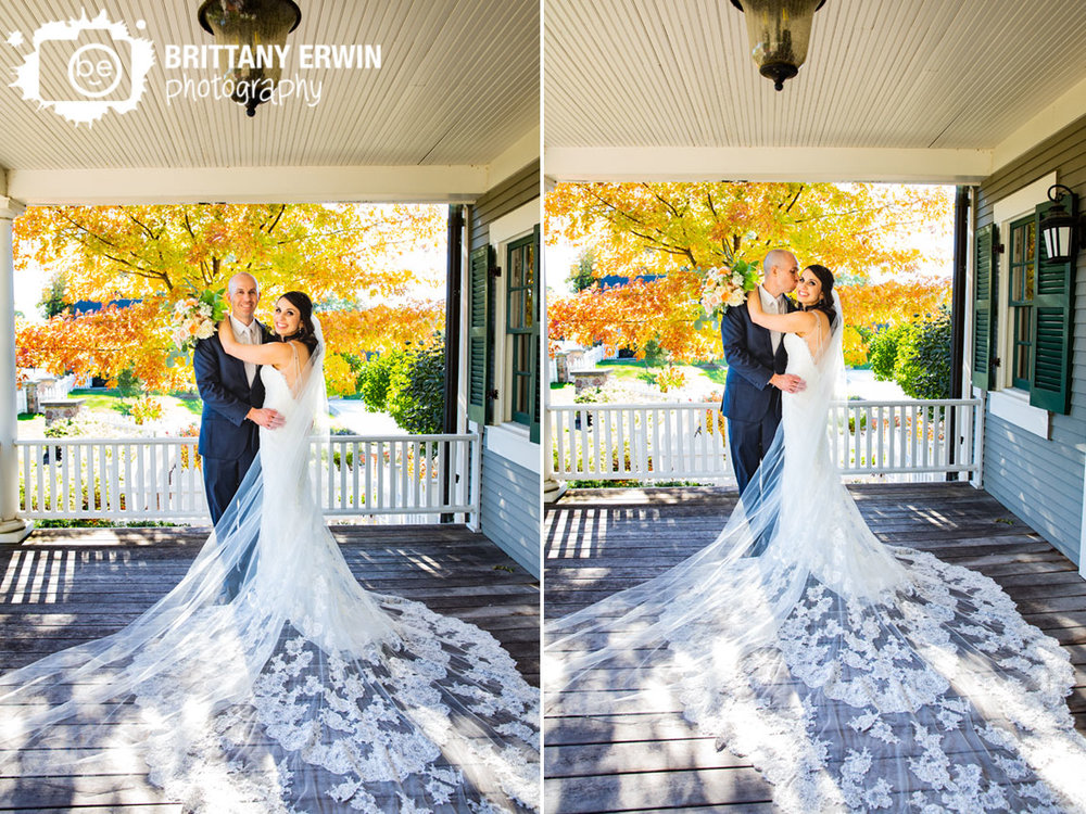 Historic-Ambassador-House-wedding-photographer-couple-on-porch-cathedral-length-train-lace-with-long-veil.jpg
