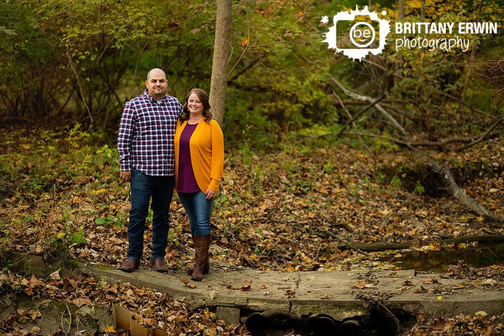 Indianapolis-fall-portrait-photography-engagement-session-leaves-concrete-bridge.jpg
