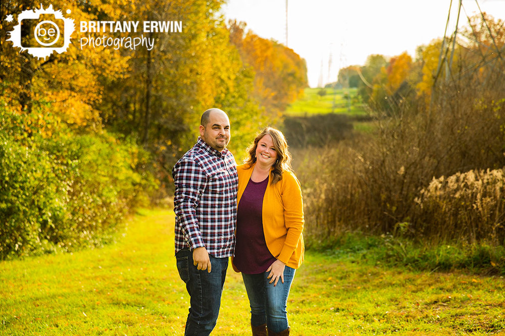 Sunset-engagement-session-couple-on-path-fall-leaves.jpg