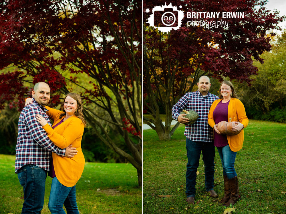 Camby-Indiana-fall-engagement-photographer-couple-under-japenese-maple-red-leaves.jpg