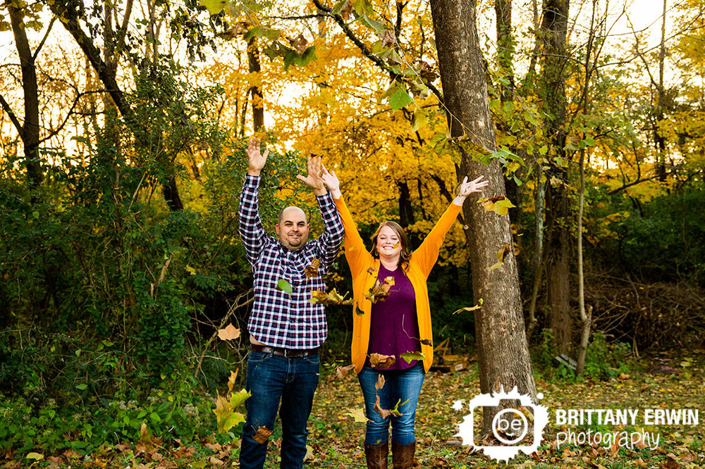 Fall-leaves-throw-in-air-engagement-couple-outdoor-fun-photographer.jpg
