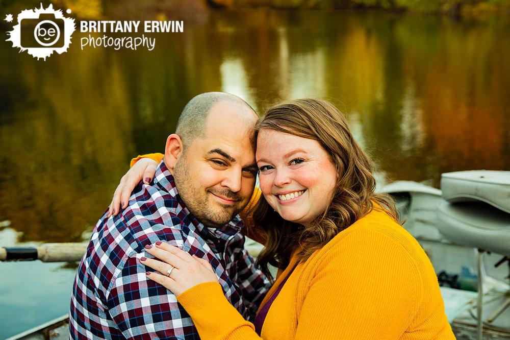 Indianapolis-couple-on-boat-engagement-portrait-photographer-snuggled-on-bench.jpg