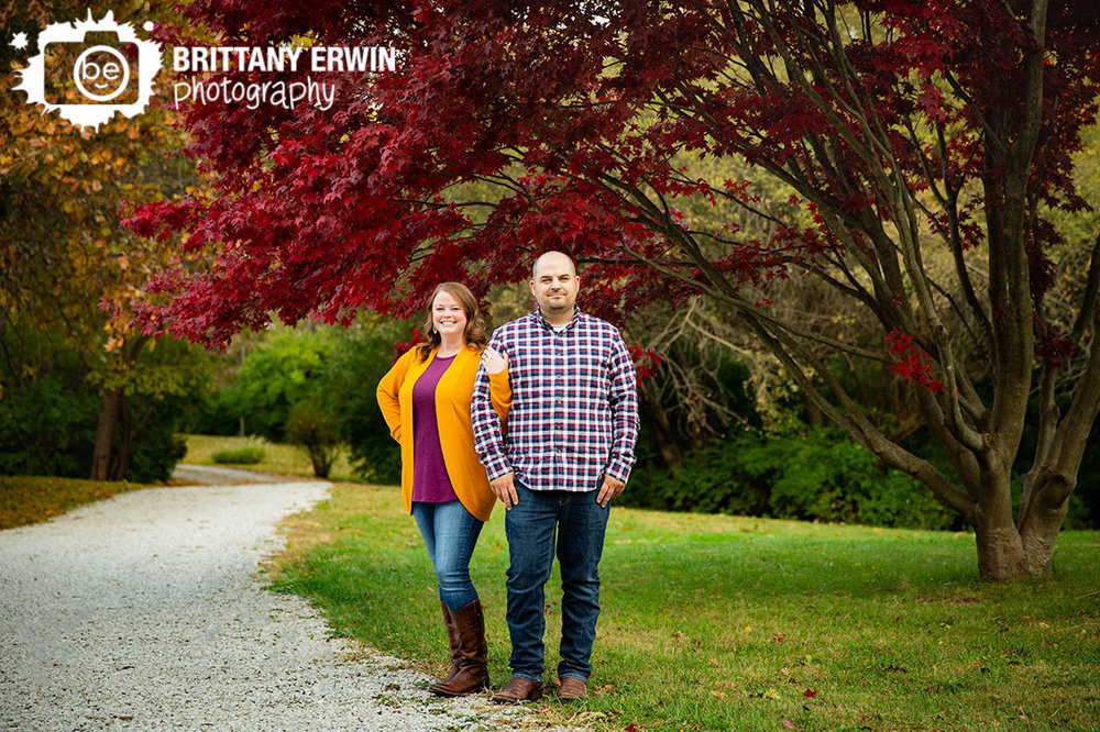 Camby-Fall-engagement-portrait-photographer-couple-under-japenese-maple-red-leaves-path.jpg