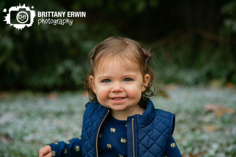 Camby-winter-snow-portrait-photographer-toddler-girl-navy-vest.jpg