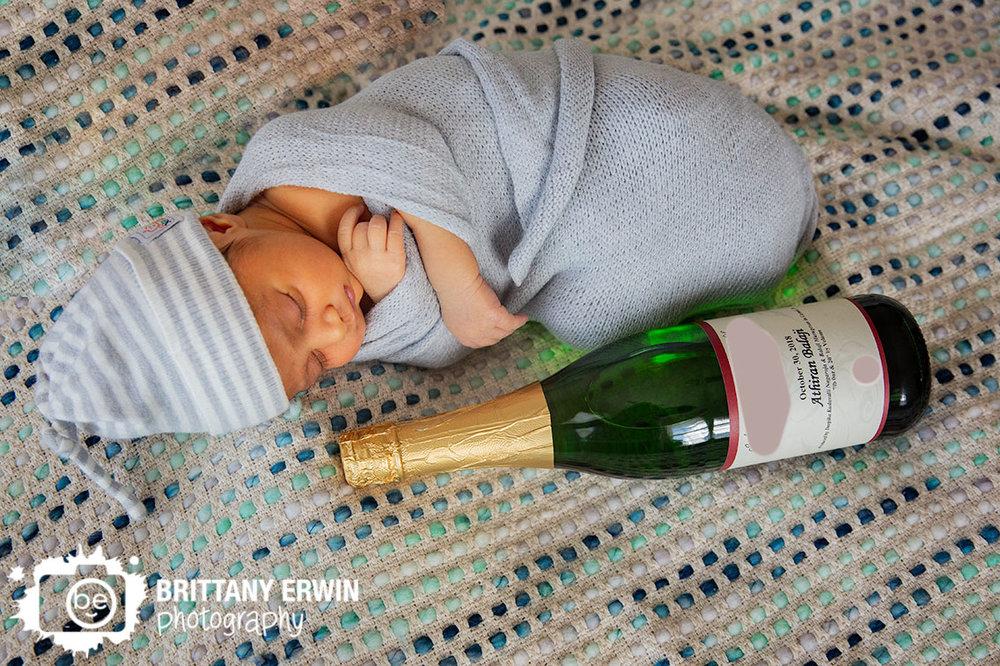 Indianapolis-lifestyle-photographer-baby-boy-newborn-with-champagne-bottle-custom.jpg