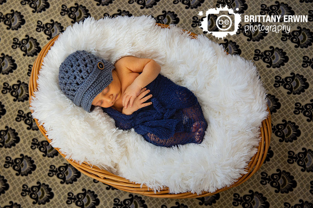 Indianapolis-newborn-lifestyle-photographer-patterned-blanket-fur-sleeping-wrapped-boy.jpg