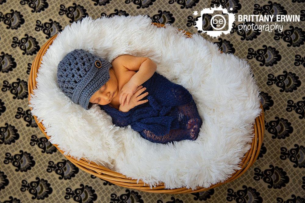 Indianapolis-newborn-lifestyle-photographer-patterned-blanket-fur-sleeping-wrapped-boy.jpg