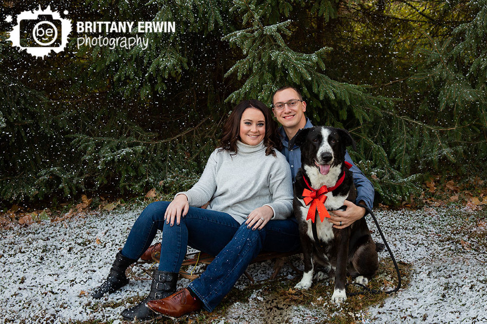 Indianapolis-snow-portrait-session-photographer-couple-with-dog-pet-bow-collar.jpg