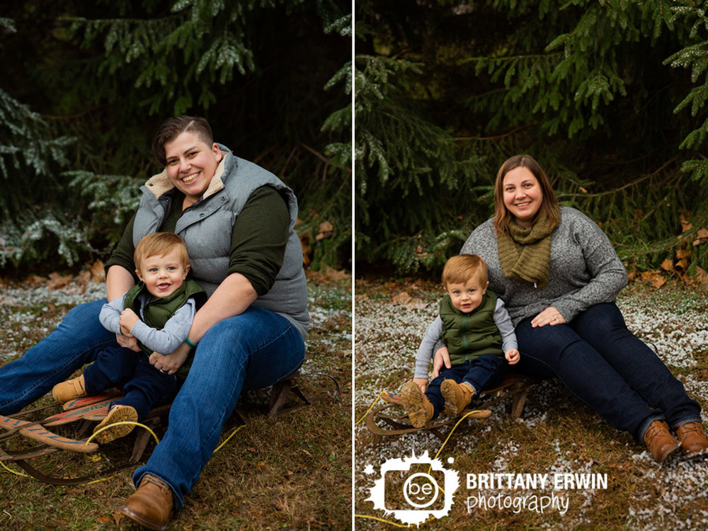 Indianapolis-family-portrait-photographer-mom-with-son-on-sled-snow-silly.jpg